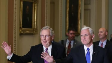 Mitch McConnell and Mike Pence, plotting to repeal ObamaCare