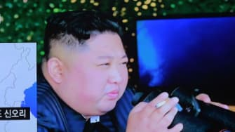 South Koreans watch news about North Korean missile launch