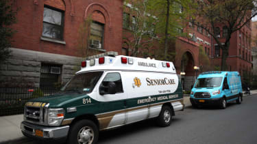 Two ambulances sit parked outside the Cobble Hill Health Center