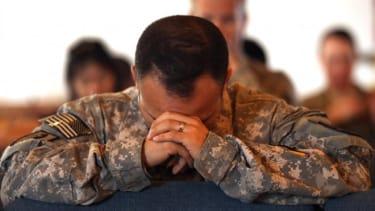 U.S. Army soldiers pray