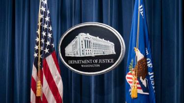Justice Department logo.