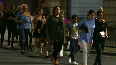 Concertgoers leave the Manchester Arena Monday night.
