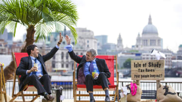 Protesters set up a fake tax haven in London.