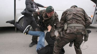 Turkish PM's aide caught on camera kicking mine protester