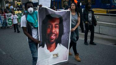 People protest the verdict in the Philando Castile case.