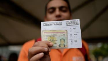 A voter in Venezuela's protest election