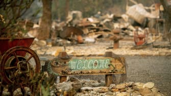 A welcome sign outside a destroyed home in Paradise, California.