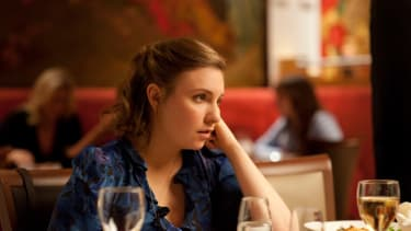 Hannah Horvath, bored at a restaurant