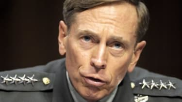Then-CIA Director-desigate Gen. David Petraeus testifies on Capitol Hill in Washington in June 2011: On Monday the FBI removed boxes of materials from the home of Petraeus' mistress, Paula Br