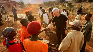 Bill Clintons travels to Africa with the Clinton Foundation.