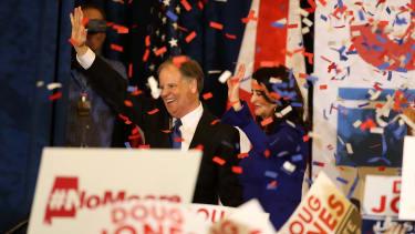 Doug Jones celebrates his election night win