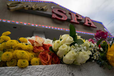 Flowers left in honor of the Atlanta shooting victims.