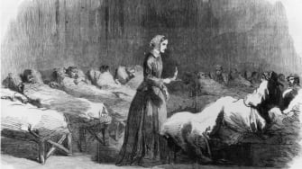 Florence Nightingale looks in on her patients