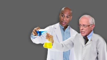 Bernie Sanders and Corey Booker in lab coats mixing their plans for guaranteed jobs