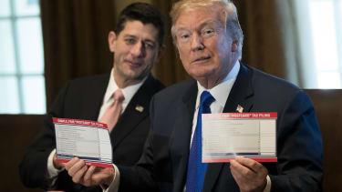 President Trump holds the GOP's tax reform postcard.