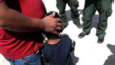 Migrants and border patrol agents.