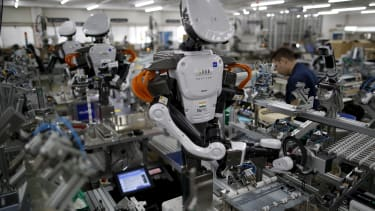 Robots working on the assembly line at a factory in Tokyo.