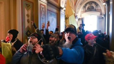 Supporters of US President Donald Trump protest inside the US Capitol on January 6, 2021.