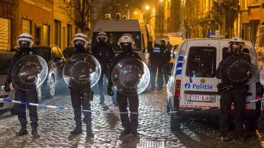 Belgian police block off a street during a raid in Brussels.