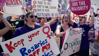Abortion rights activists cheer the court's decision Monday.