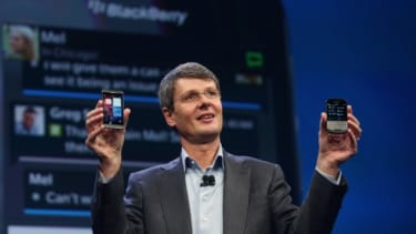 Thorsten Heins, the Chief Executive of BlackBerry shows off the new Blackberry 10 smartphones.