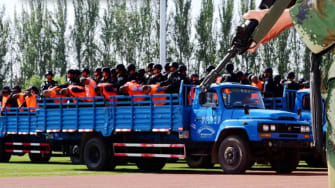 China sentences 55 prisoners in front of 7,000-person stadium audience