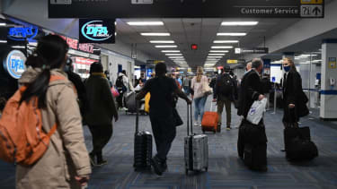 Travlers at Dulles International Airport on Sunday.