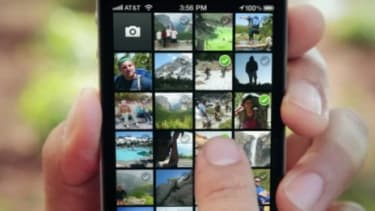 On Facebook's Instagram-like camera app, users can select multiple photos to upload directly onto their Facebook wall.