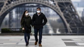 A couple wearing masks