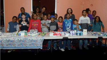 Jahkil (front, gray shirt), his friends, and the makings of their blessing bags.