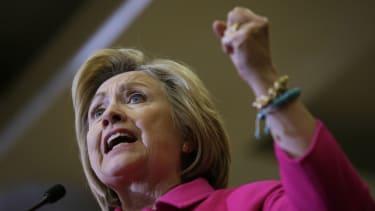 Hillary Clinton questions Bernie Sander's health plan.