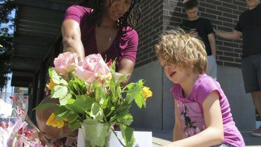 Portlanders at a memorial for two men defending two teenage girls