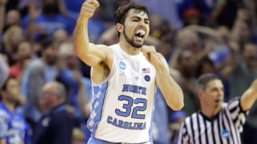 UNC player cheers as his team makes the NCAA championship.