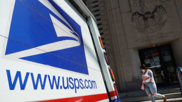 A postal vehicles sits in front of a United State Postal Service facility on August 13, 2020 in Chicago, Illinois.