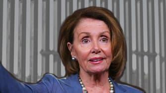 Nancy Pelosi surrendering border wall.