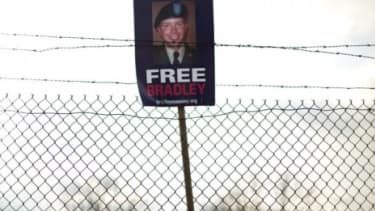 """A """"Free Bradley Manning"""" sign hangs from barbed wire in Fort Meade, Maryland: The accused WikiLeaks informant has been nominated for the Nobel Peace Prize."""