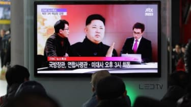 South Koreans watch a television broadcast reporting North Korea's nuclear test at the Seoul Railway station on Feb. 12.