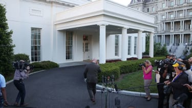 H.R. McMaster walks away after reading a statement
