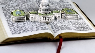 A Bible and the Capitol Building.