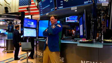 A stock trader reacts to Trump's tariffs on the NYSE