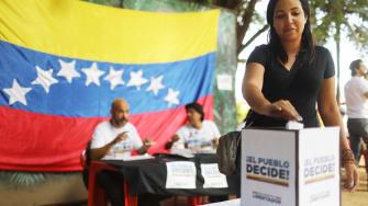 A Venezuelan woman votes in a symbolic referendum.