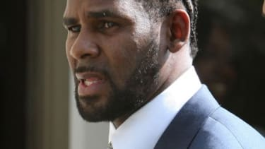 R&B singer R. Kelly owes about $4.8 million in unpaid taxes, according to the IRS.