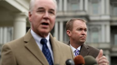 Tom Price (L) and Mick Mulvaney talk to reporters following the release of the Congressional Budget Office report.