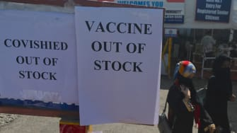 Signs indicating Oxford-AstraZeneca vaccines are out of stock in India.
