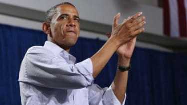 President Obama at a campaign rally in Florida on Sept. 8: In August, the Democrat narrowly outraised GOP challenger Mitt Romney, hauling in some $114 million.