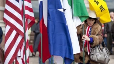A Tea Party member holds a flag during a January rally in Texas.
