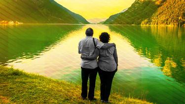 A couple at a lake.