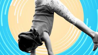 A girl doing a cartwheel.
