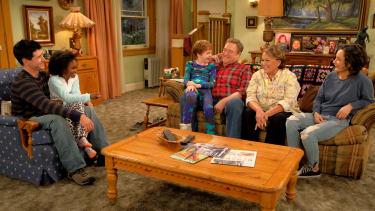 Cast members of Roseanne.