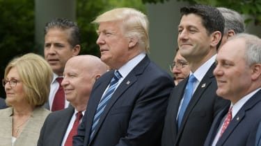 Trump stands with Republican members of the House after the passage of the GOP health-care bill.